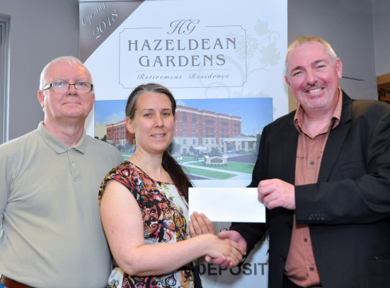 Chris Jackson, right, Hazeldean Gardens' Community Relations Manager presents a cheque to Kathryn Jamieson, Goulbourn Museum Curator Manager and Ken Cownley, Museum Chairperson.